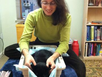 Dr. Matthews doing chiropractic on a longterm cancer survivor.