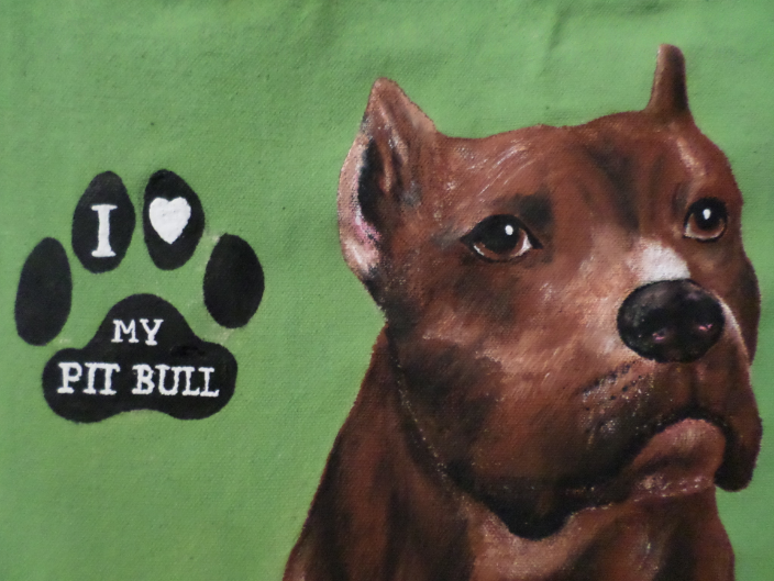 This is a beautiful Pit Bull I painted on a canvas tote bag.