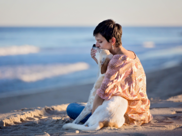 Woman with her dog on the beach