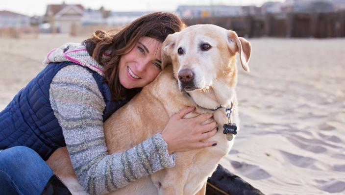 Woman with dog at Bradley Beach, NJ