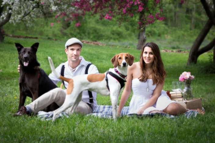 Couple with their dogs in Holmdel Park, NJ