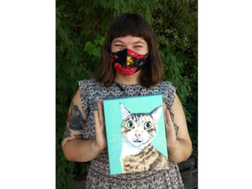 """Happy client holding her new painting of her cat Scout, 8x10"""" canvas."""