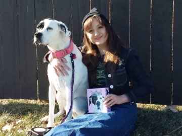 """Happy client poses with pup Rosie and her new painting, 6x6"""" canvas."""