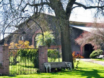 Front of our arena barn, designed by Marjory F. Tone, and Fadjur's pasture gate on Jack Tone Ranch