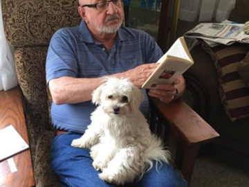 Dwain and Focus, our Maltese dog