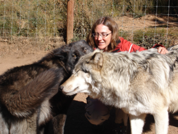 Kim with two wolves