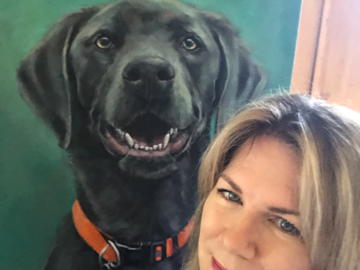 Julie Dalton Gourgues with recent commissioned portrait of a silver lab called Pepper.