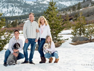 Family in snow with dogs