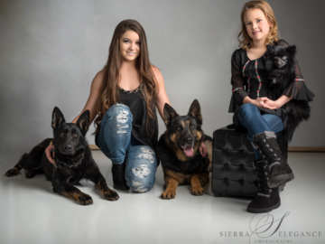Girls and three dogs
