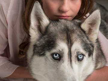 Girl with Siberian Husky