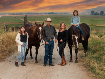 Family with horses and sunset