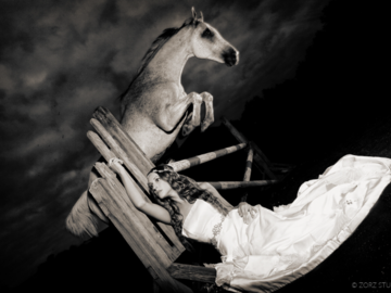 A horse jumping over a bride against a dramatic sky